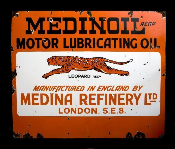 A large enamel sign advertising Medinoil - Motor Lubricating Oil. Manufactured in England by Medina Refinery Limited of London SE8. *EDITORIAL USE ONLY*