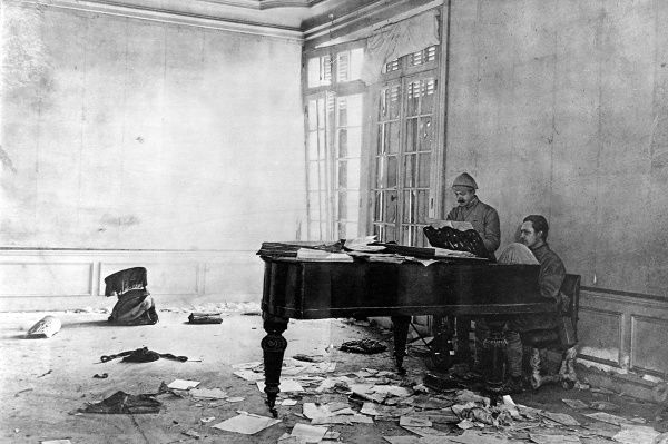 A photograph of two French army officers at a grand piano found in a ruined Chteau, August 1916&quot