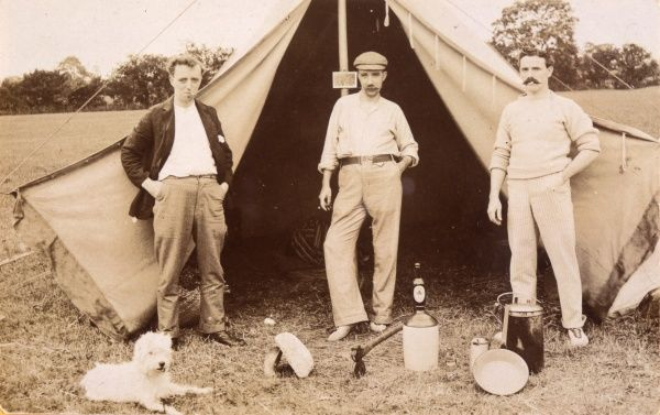 Three men in a tent (to say nothing of the dog) : a bottle of Bass is in evidence