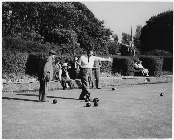 Men playing bowls on a bowling green