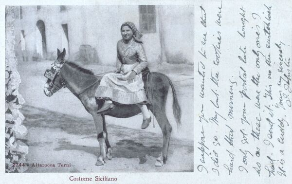 Messina, Italy - Woman in Sicilian Costume sitting sidesaddle on a donkey Date: 1908