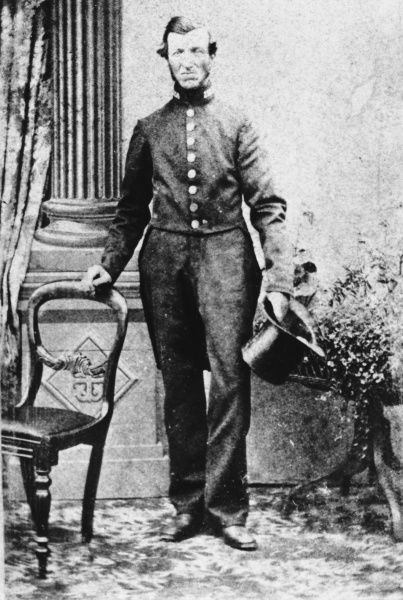 A Metropolitan Police officer, PC Vincent, in the mid-Victorian period, posing for his photograph in a studio