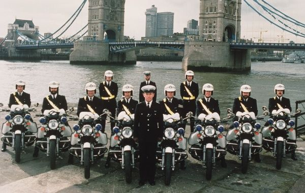 A group of Metropolitan Police motor cyclists, with the River Thames and Tower Bridge in the background