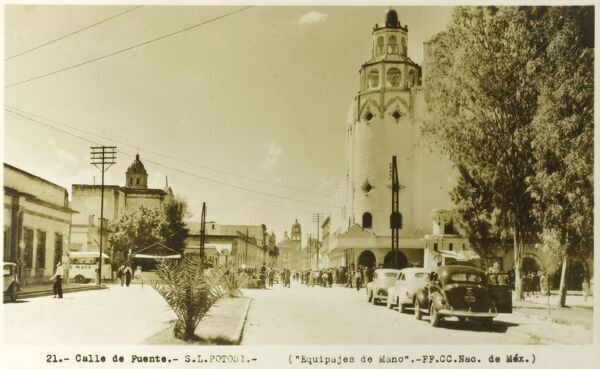 Calle de Puente, in San Luis Potosi (commonly called SLP or simply San Luis), the capital of the Mexican state of the same name. View toward one of the distinctive tower of the Templo del Carmen. Date: late 1930s