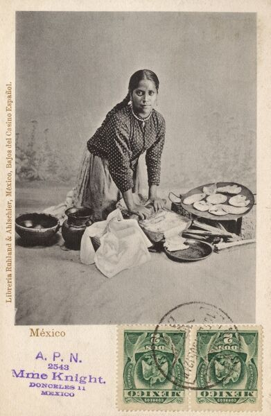 Mexico - Lady making tortillas. She is rolling out the dough on a stone (with a rolling pin), shaping the tortillas and cooking them on a hot plate. Date: circa 1905