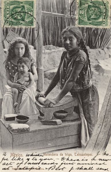 A young girl grinding wheat on a stone, Isthmus of Tehuantepec, Mexico