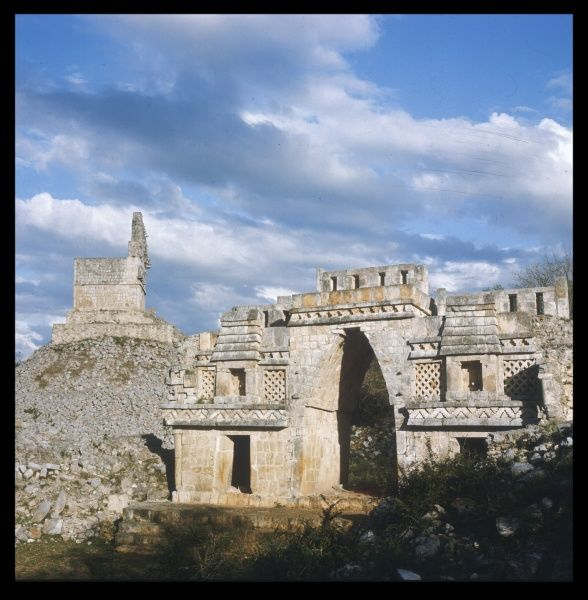 The ARCHWAY of the ancient city of Labna, Yucatan with the MIRADOR standing on the ruins of a pyramid in the background. The city was built in the 9th/10th century