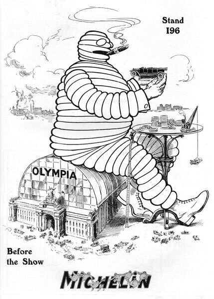 The Michelin Man sits atop Olympia and makes sure all the exhibits for the 1913 motor show are equipped with the best tyres. Date: 1913