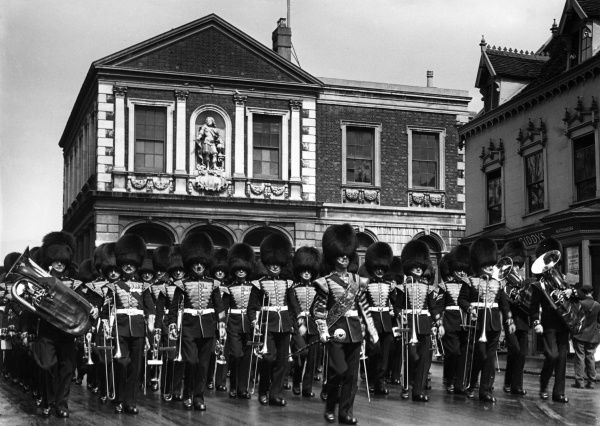 The guards at Windsor march through the streets. Date