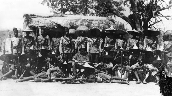 Lieutenant Lane of the M.I.N. Regiment, in a group photo with native soldiers at Sava, Cameroon, west central Africa, during the First World War. Date: 1914