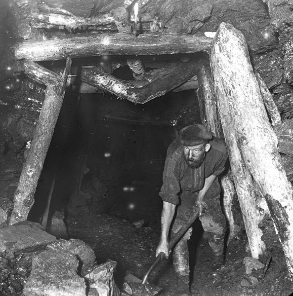 A miner working in the Plas y Coed Level, South Wales