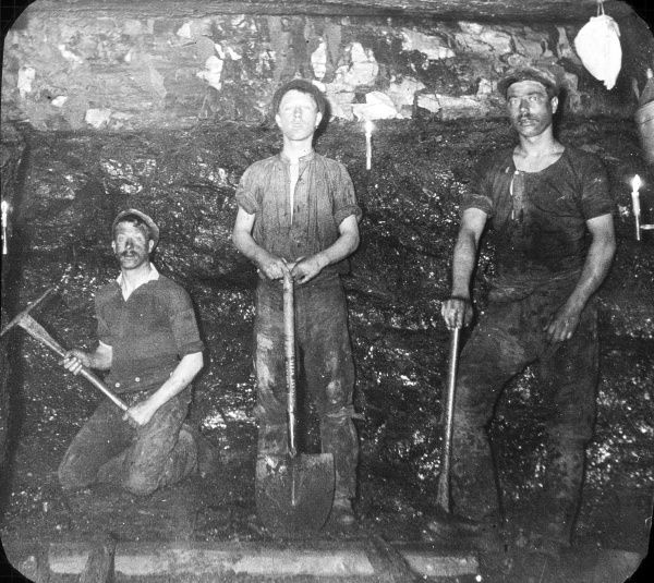 Three miners in a coal seam at Baldwin's Clog and Legging Level, near Pontypool in South Wales