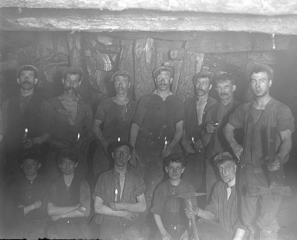 A group of miners from the morning shift pose for their photo in a coal seam at Baldwin's Level, Pontypool, South Wales