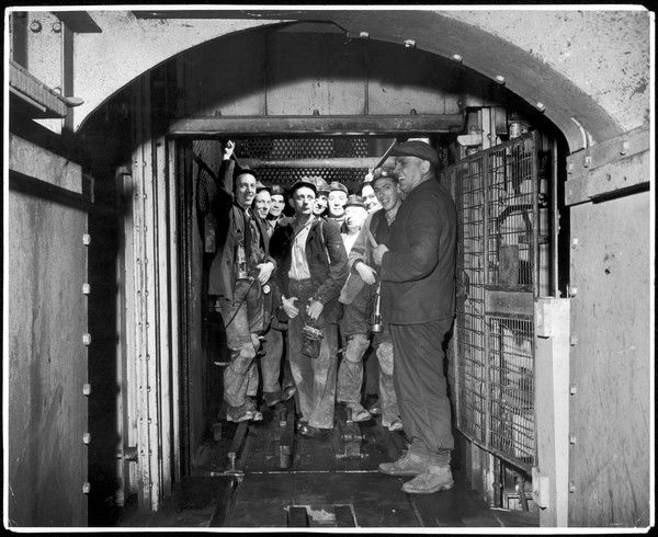 Miners about to descend for their shift underground at Lynemouth Colliery
