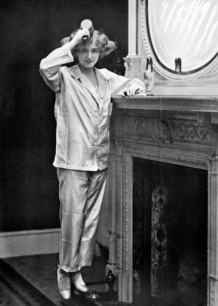 Gabrielle Ray (1883-1973), British stage actress brushing her hair and wearing pyjamas