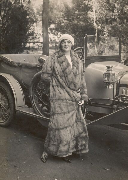 "Miss Mabel Green (Actress and vocalist, born London 1890 - died c.1970), standing alongside her fine open-top Sunbeam car (""which she drives herself"") at Johannesburg, South Africa. Miss Green was married in Johannesburg to Mr Stanley Steele"
