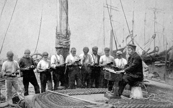 Photograph showing a Mission to Seamen Service being held on the deck of a barge, 1906