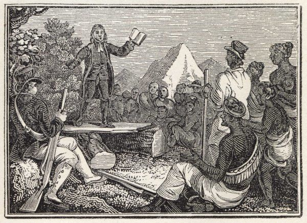 Missionaries preaching to native Americans