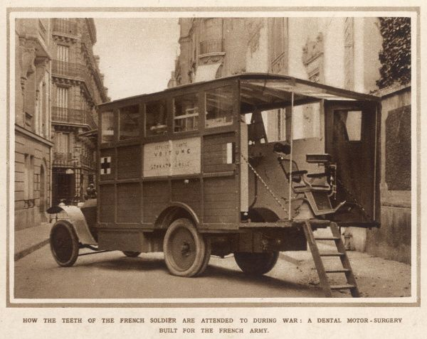 A French motor lorry has been converted to make a dentist laboratory, to care for the teeth of the soldiers. The adjustable seat can just be seen