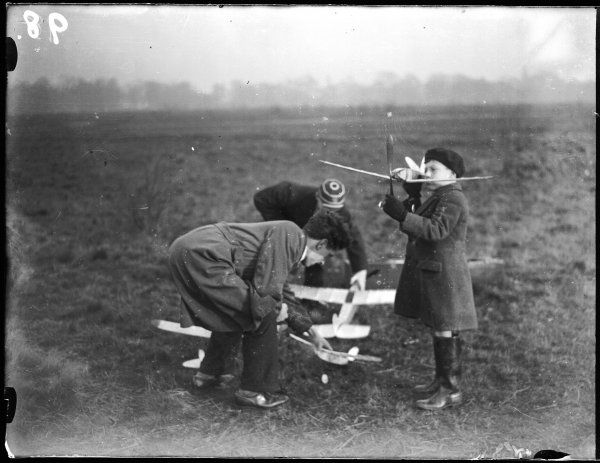 Playing with model aeroplanes on Wimbledon Common, London, England