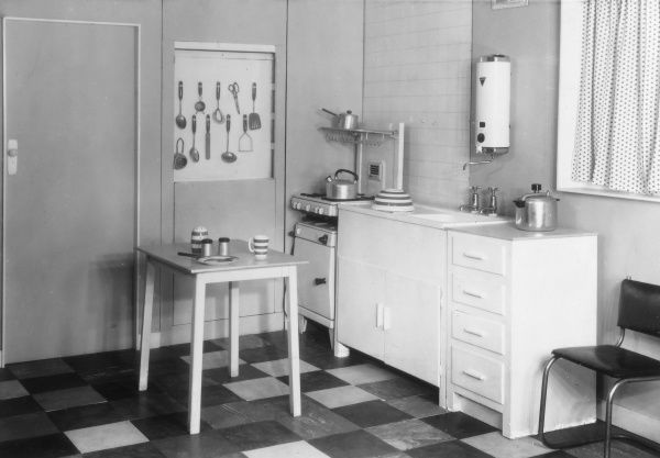 A 'modern' (but now rather basic looking!) British kitchen, with a gas cooker in the corner. Date: early 1960s