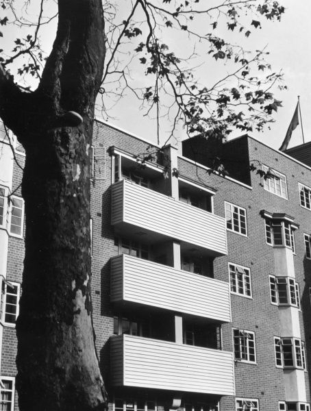 A 'modern' block of flats, with weatherboarded balconies, Kingston-on-Thames, Surrey, England. Date: 1930s