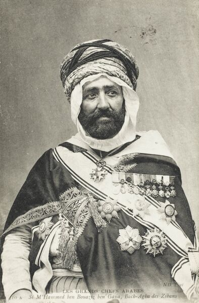 A fine portrait of Mohammed Ben Bouaziz Ben Gana - one of the most important Algerian Arab Sheikhs - much decorated by Western powers, particularly the French, to whom he was a Satrap