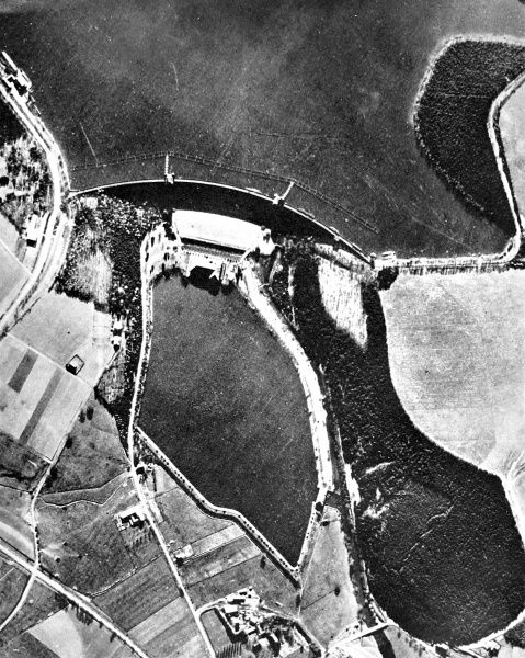 Aerial photograph showing the Mohne Dam and reservoir (top) before the 'Dambusters' raid of 16th May 1943. Anti-torpedo nets can be seen just above the dam in this photograph