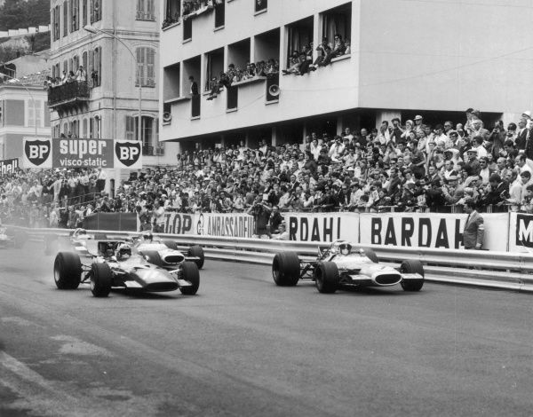 Jackie Stewart, in a Matra- Ford (7), leads Chris Amon's Ferrari (11) away from the grid at the start of the Monaco Grand Prix. Both failed to finish the race