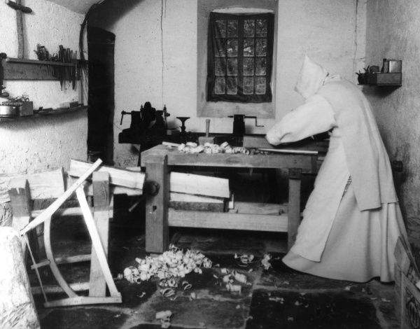 A Carthusian monk carpenter at work at the monastery of La Valsainte, Switzerland. Date: early 1940s