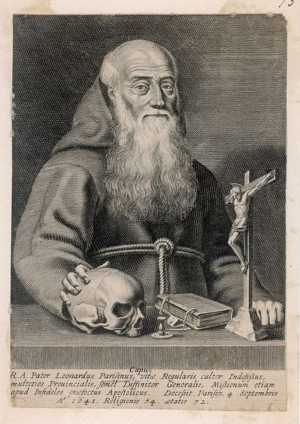 Father Leonard Parisinus, a missionary monk, with a selection of significant items - a skull, a crucifix, a missal and an empty candlestick