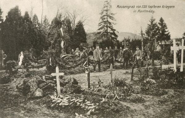 Mass grave of 520 'brave warriors' in Montmedy. A German postcard of 1915, depicting the site of a mass burial of German soldiers killed in the early years of WWI. The graves also contains soldiers from France, Belgium, Italy and Russia
