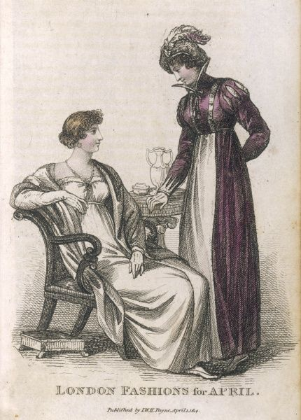 Morning dress: purple velvet open pelisse with Andalusian sleeves let in with white; neck & sleeves of lace a la vandyke. Evening dress: white satin gown with accesssories