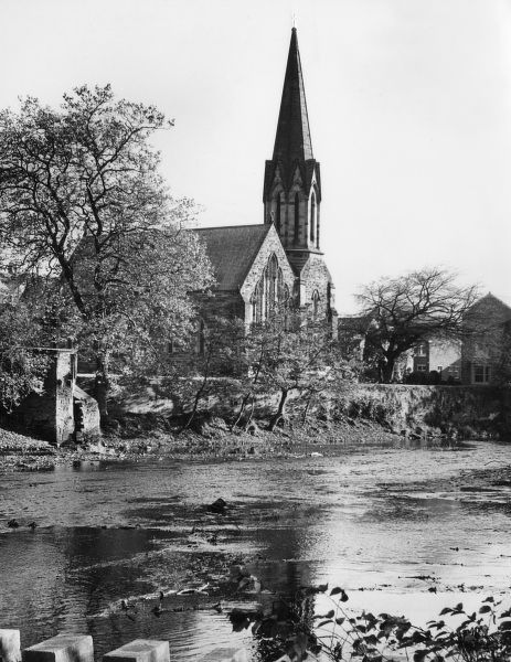 The fine Roman Catholic Church of St. Robert of Newminster, situated by the River Wansbeck, at Morpeth, Northumberland, England. Date: 1950s photo
