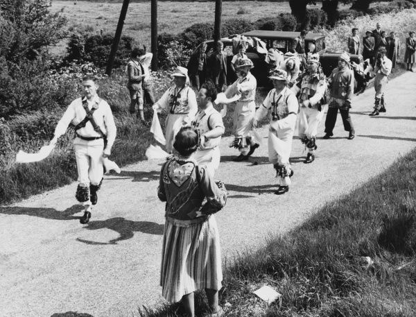 MORRIS DANCING: Thaxted, Essex. The dancers, as well as performing in the town, also dance in the country lanes and for isolated cottages and farms. Date: 1950s