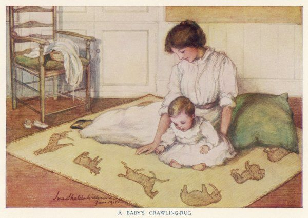 Mother and baby sitting on a crawling rug which is decorated with pictures of animals