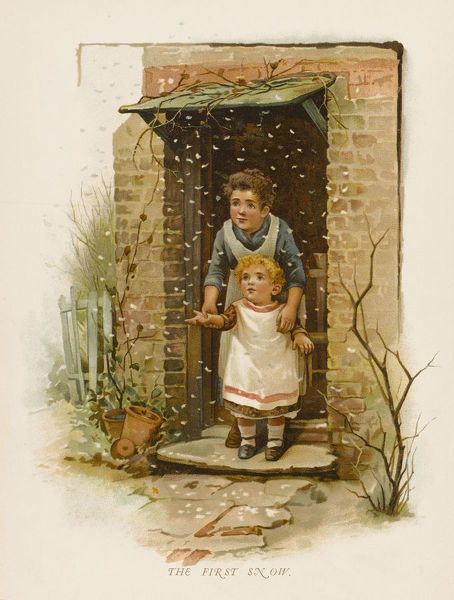 The first snow of the year - two children stand at the door of the house watching the snowflakes as they fall