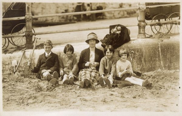 A delightful photograph of a Mother and her four children spending the day on the beach at Palm Bay, Cliftonville, Margate, Kent. It looks as if Ma if knittinga jumper for her youngest daughter, having already produced two for her elder female siblings