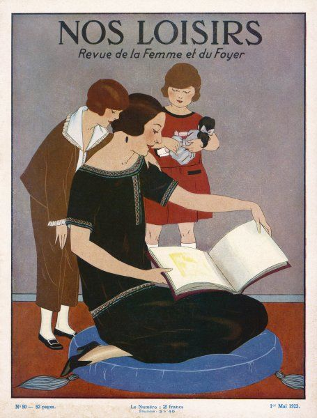 Maman and her two daughters look at a picture book