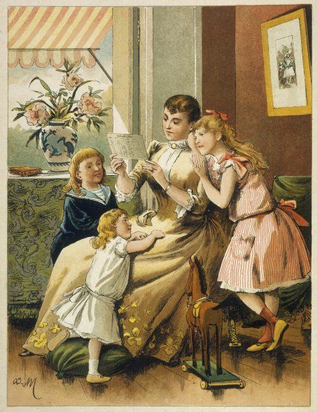 A French maman reads to her three enfants
