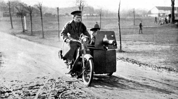 A motor-cycle with a side-car machine gun