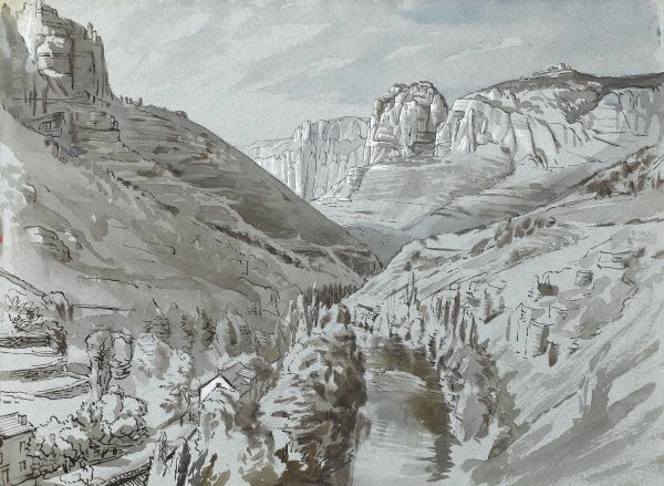 A mountain landscape with high rocky outcrops and buildings in the valley
