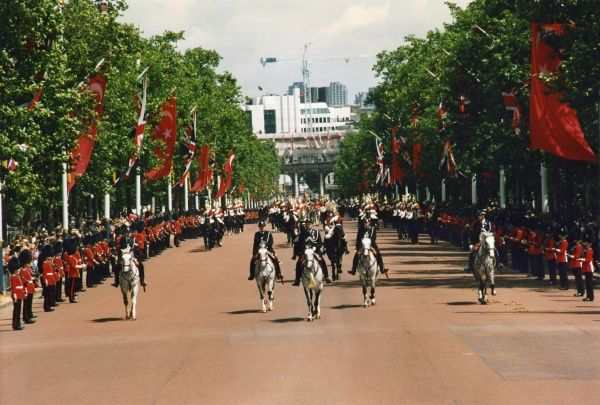 Mounted Police Officers take part in a procession along The Mall, London, heading toward Buckingham Palace from Admiralty Arch. The procession appears to be in commemoration of an official state visit by members of the Turkish Government