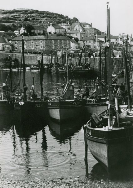Fishing boats in the harbour at Mousehole, Cornwall Date: 1929