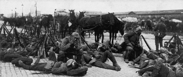 German troops being entertained by a comrade's mouth-organ while they rest after a long march into Brussels in September 1914, shortly after the outbreak of World War I