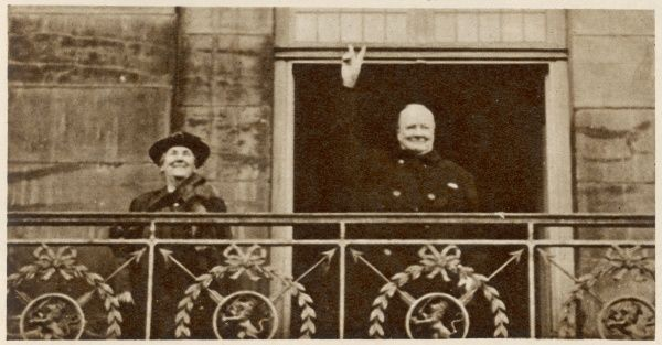 Giving the V-sign to the great crowds which assembled to cheer him when, accompanied by Queen Wilhemina of the Netherlands, he came out on to the balcony of the Royal Palace at Amsterdam