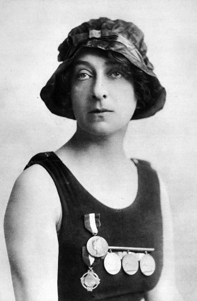 Photographic portrait of Mrs. Arthur Hamilton, famous society swimmer, dressed in her bathing costume, c.1915. Mrs. Hamilton was the first woman to swim the Solent and made several cross-Channel attempts