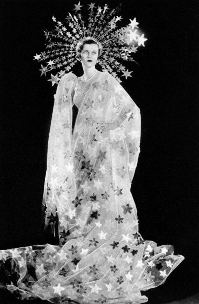 Mrs Charles Sweeny, formerly Miss Margaret Whigham and later the Duchess of Argyll (1912 - 1993), pictured as Astrae, the Star-Maiden for the Olympian Party at Claridges on 5 March 1935 in aid of the Greater London Fund for the Blind