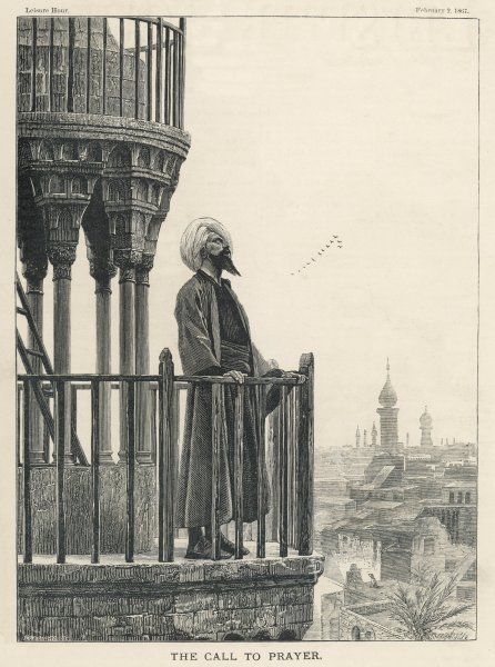 The Muezzin calls the faithful to prayer from a minaret