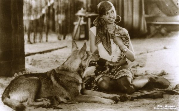 Music Hall performer, actress and singer Josephine Baker (1906-1975) - pictured with a large German Shephard dog. Date: circa 1910